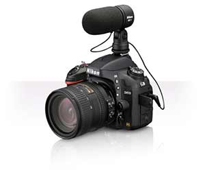 Nikon D610 product photo with a lens and the ME-1 stereo microphone attached.